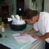 Tanroo signing his visa form !