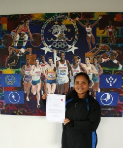 Daniel with her Olympic Scholarship certificate.