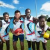 KING OF THE KIDS: Former Carlton and GWS Giants player Setanta Ó hAilpín with All Nations Cup players Blaise Singizwa (Kenya), Kaman Malou (South Sudan) and James Demby (Sierra Leone). Photo: Trevor Veale/Coffs Coast Advocate