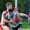 Port Macquarie's Luke Long is wrapped up in a tackle against the Coffs Swans. Photo: Rob Wright/Coffs Coast Advocate
