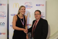 Joe Hutchison Medal A grade best and fairest Montana Holmes of Moe with Steve Hutchison
