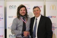 Reserves Hartley Medal winner Nicholas Tucker of Wonthaggi Power (left) with TRFM Gippsland League chair Greg Maidment (right)